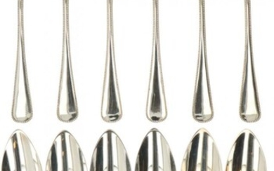A (12) piece set of silver dinner spoons.