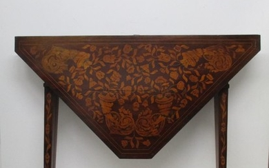A 19th century Dutch walnut and marquetry folding card table...