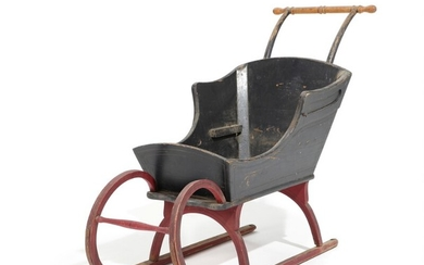 A 19th century painted wood and metal child's sleigh. H. 90. L. 115. W. 50 cm.