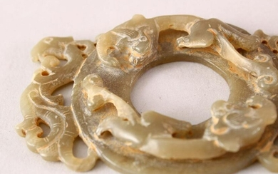 A CHINESE CARVED GREEN JADE CHILONG DISK / PENDANT