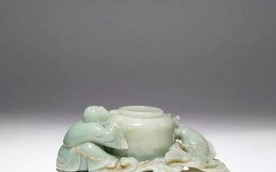 A CHINESE CELADON JADE BRUSH WASHER QING DYNASTY The beehive-shaped...