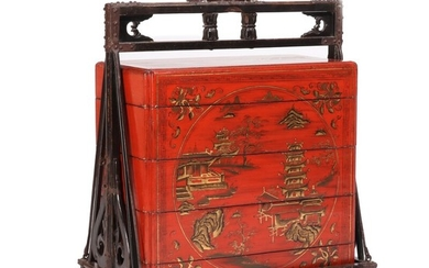 A Chinese 19th century red lacquer wedding chest, decorated in gold with architecture and landscapes. H. 96. L. 83. W. 51 cm.