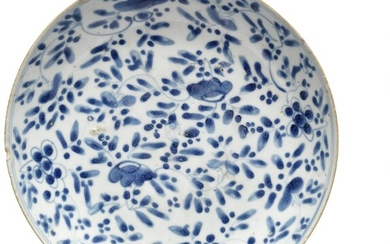 A Chinese Ming porcelain dish decorated in underglaze blue with flowers and foliage. 17th century. Diam 29 cm.