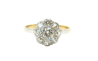 A DIAMOND CLUSTER RING The floraform cluster, set