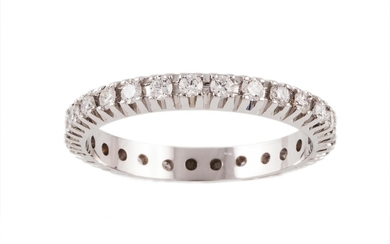 A DIAMOND FULL ETERNITY RING, with diamonds of 0.62ct in tot...