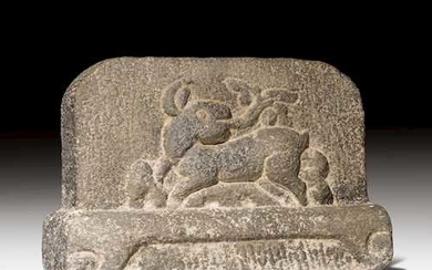 A GREY STONE RELIEF CARVED WITH A RABBIT.