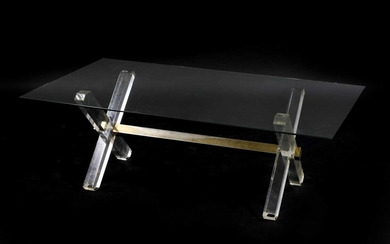 A Lucite and glass coffee table