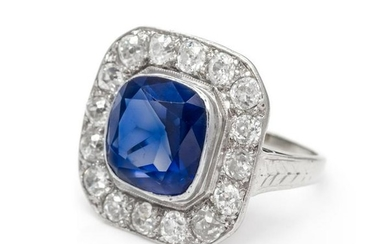 A Platinum, White Gold, Synthetic Sapphire and Diamond