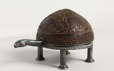 A RARE SILVER AND COCONUT SHELL CLOCK, formed as a