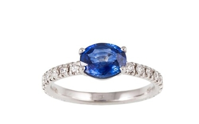 A SAPPHIRE SINGLE STONE RING, the oval sapphire to brilliant...