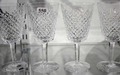 A SET OF FOUR WATERFORD WINE GLASSES