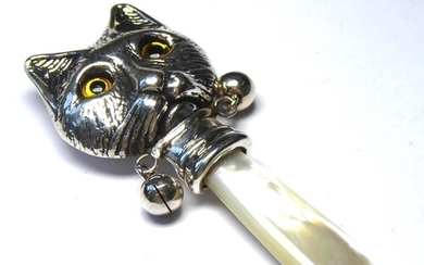 A STERLING SILVER AND MOTHER OF PEARL CAT FORM BABIES RATTLE...