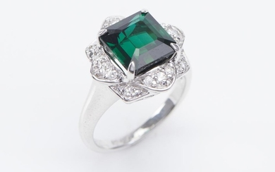 A TOURMALINE AND DIAMOND RING-Centrally set with a square emerald cut green tourmaline weighing 5.00cts, within a floral border of r...