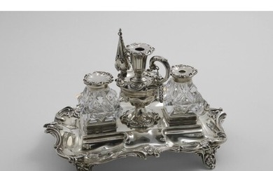 A VICTORIAN INKSTAND of shaped rectangular outline with a hu...