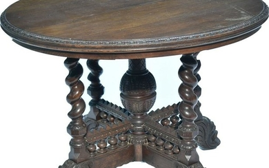 A Victorian carved oak centre table.