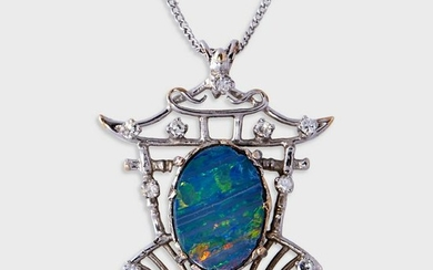 A black opal doublet, diamond, and fourteen karat white