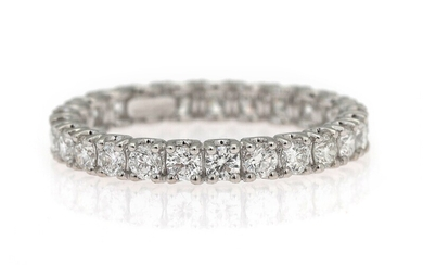 NOT SOLD. A diamond eternity ring set with numerous diamonds weighing a total of app....