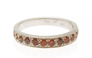 A diamond ring set with numerous brilliant-cut orange diamonds weighing a total of app. 0.50 ct., mounted in 18k white gold. Size 54.