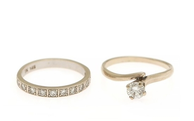 A diamond solitaire ring and an eternity ring respectively set with one or numerous brilliant-cut diamonds, mounted in 14k white gold. Size 58 and 59. (2)