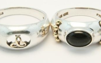 A group of 4 sterling & gold rings