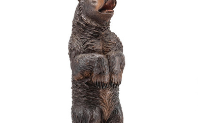 A late 19th/early 20th century Black Forest carved and stained lindenwood model of a standing bear
