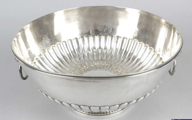 A late Victorian silver punch or rose bowl with twin lion mask handles.