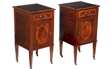 A pair of Edwardian mahogany bedside cupboards