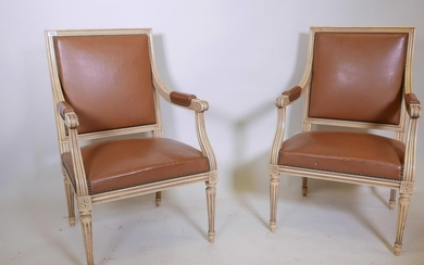 A pair of French style painted open armchairs, with brass st...
