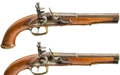 A pair of German flintlock pistols with silver and gold