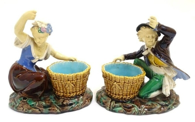 A pair of Minton style majolica figures after designs