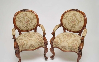A pair of Victorian upholstered oak elbow chairs, with...