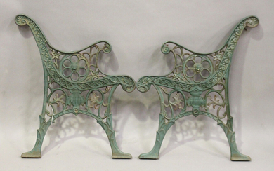 A pair of early 20th century green painted cast iron garden bench ends, height 72cm, depth 61cm.