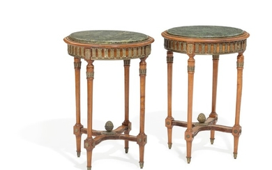 A pair of stained beech lamp tables, decorated with bronze mountings, green marble tops. 20th century. H. 75. Diam. 53 cm. (2)