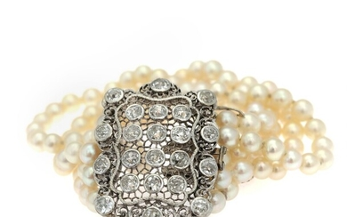 NOT SOLD. A pearl and diamond bracelet set with numerous cultured freshwater pearls and old-cut...