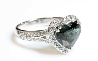 A platinum green sapphire and diamond heart-shaped halo cluster ring