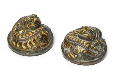 A rare pair of Chinese bronze and inlaid 'tiger' mat...