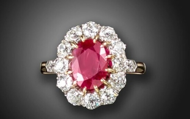 A ruby and diamond cluster ring, the oval-shaped ruby set within a surround of old circular-cut diamonds, with a diamond to each shoulder in platinum on gold, size R Accompanied by report number 80275-32 dated 15 September 2020 from GCS stating that...