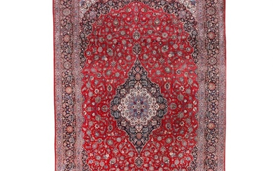 A signed semiantique Kashan carpet, Persia. Classical medallion design. Fine shiny wool quality. Signed: Alagehehmand. Second half 20th century. 529×341 cm.