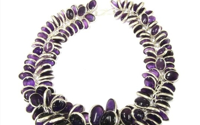 A silver graduated amethyst garland necklace