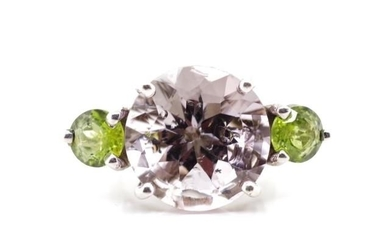 Amethyst and peridot set 9ct white gold ring in the cocktail...