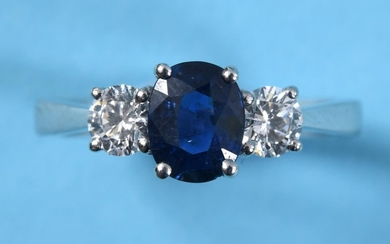 An 18ct white gold sapphire and diamond three stone ring, ap...