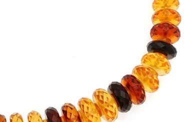 An amber necklace set with numerous amber roundels. L. 52 cm.