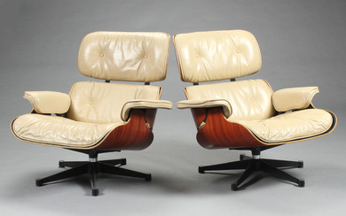 Charles Eames. Lounge chairs, rosewood and leather (2)