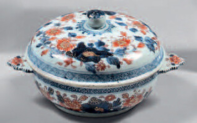 China porcelain bowl and lid. 18th century. Curved shape, flat handles, Imari decoration of flowered rocks, gin, small gold wears.