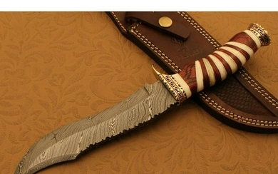 Damascus steel knife, camel bone and brass handle