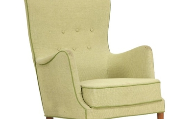 Danish furniture design: Easy chair with legs of beech, upholstered with green, button fitted wool. 1940–1950s.