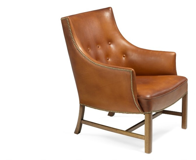 Frits Henningsen: Easy chair with mahogany frame. Upholstered with patinated brown leather, fitted with brass nails, back fitted with buttons.