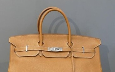Hermès bag Birkin 40 model in Clémence Gold Taurillon leather with saddle stitching and silver plated metal trim (year 2012) with cover