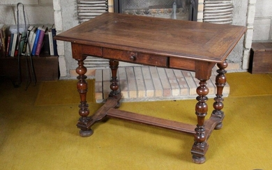Louis XIII style writing table in walnut. It rests on baluster-turned uprights, joined by an H-shaped spacer, finished with flattened boulle legs. 19th century. H : 72 x W : 102 x D : 65 cm
