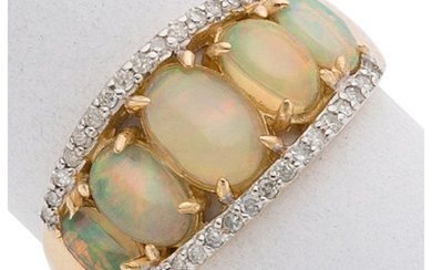 Opal, Diamond, Gold Ring The ring features oval-shaped opal...